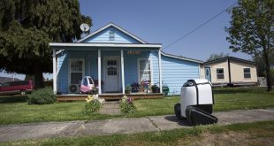 A delivery robot rolled through a neighborhood in Philomath, Ore., in April. The robot's inventor is a native of the town and hopes that with more people shopping online, such robots will take off, reducing traffic and pollution.