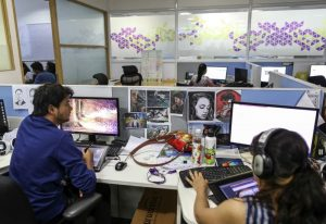 Employees work at the Think and Learn office in Bengaluru, India.