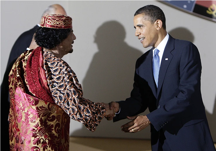 Muammar Al Gathafi (Left) & Barrack Obama (Right)